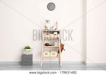 Stand-up desk with decor near light wall