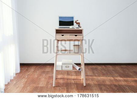 Stand-up desk with laptop in room