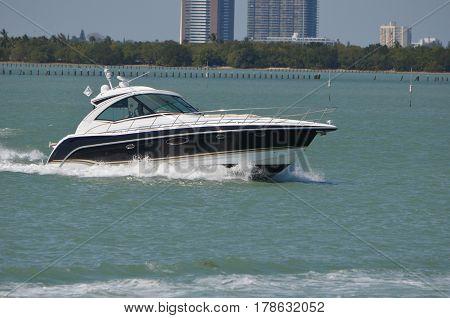 Upscale cabin cruiser speeding on the florida intra-coastaal waterway near Miami Beach.