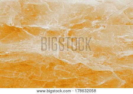 The relief colored surface of a natural stone
