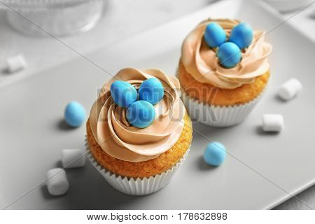 Delicious Easter cupcakes on grey plate