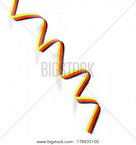 Ribbon in colors of German flag on white background
