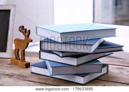 New books on wooden table