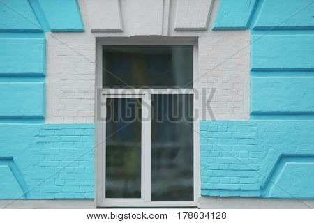 Vintage building with white plastic window