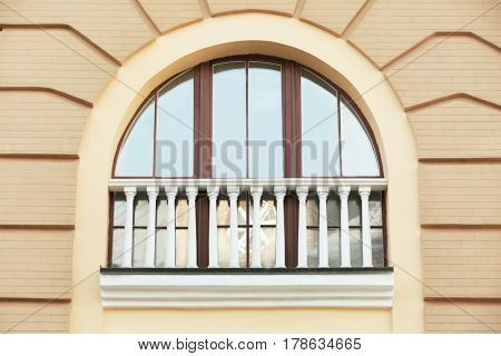 Arched window with sand wall background