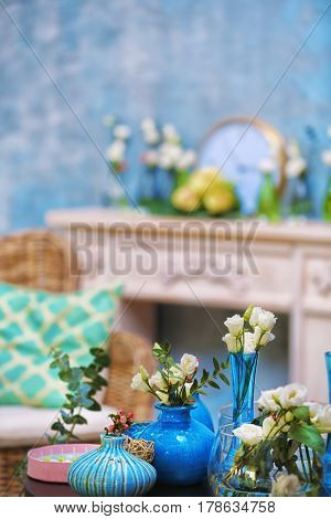 Beautiful composition with fresh flowers on blurred background