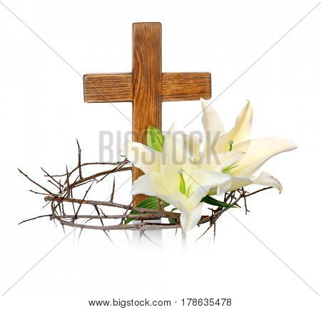Crown of thorns, wooden cross and lily on white background