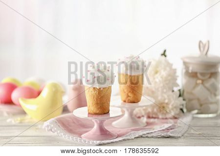 Stands with Easter cakes on blurred background