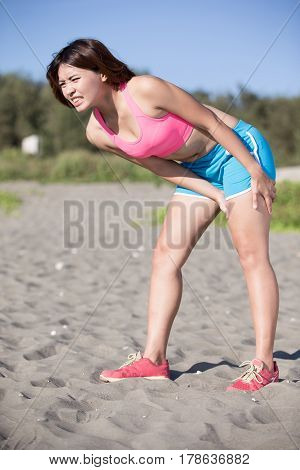 sport woman cramp in thigh and feel pain