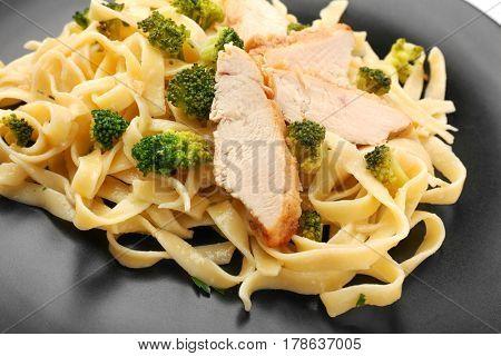 Italian chicken alfredo on plate, closeup