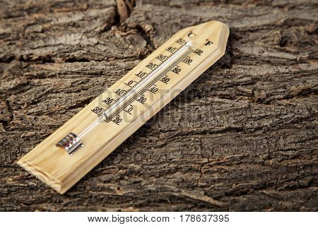 Thermometer lie  on a old wooden background