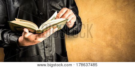 Koran in hand - holy book of Muslims ( public item of all muslims )