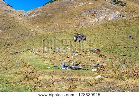 Pagan christian tomb in old village Dartlo in Tusheti Nature Reserve. Georgia poster