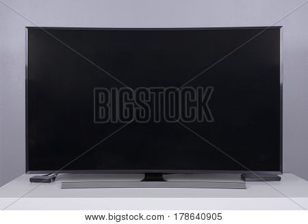 the LED TV on the white stand