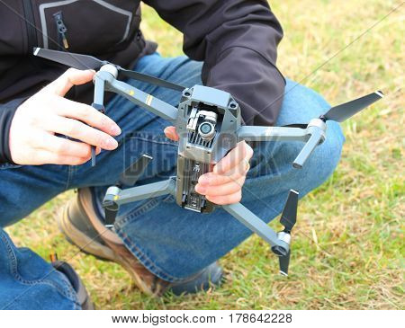 PILSEN CZECH REPUBLIC - MARCH 24, 2017: Unidentified man piloting Drone Dji Mavic Pro with 4K high resolution camera. A quadrocopter with folding arms is powerful photografic tool for traveling.