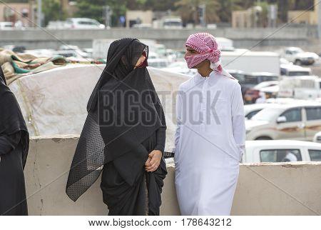 Nizwa Oma 24th March 2017: omani couple talking at the Nizwa market