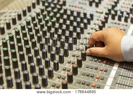 The hand adjust mixer table or fader board for music production process