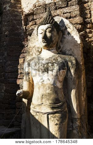 Sculpture buddha damage and sunligh at Wat Phra Si Ratanamahathat in Sisatchanalai Historical Park Sukhothai province Thailand