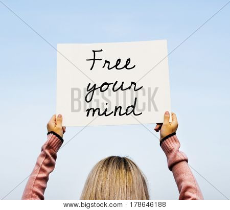 Young Woman Hands Holding Sign Said Free Your Mind