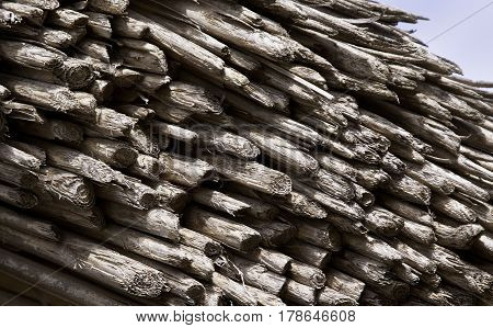 Close up corner shot of a multi-layered very old stick roof excellent alone or as a background or texture at Plimoth Plantation, Plymouth, Massachusetts on a bright sunny day in September.