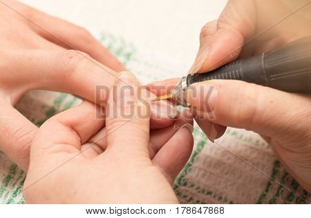 Manicure in a beauty salon . The person is engaged in work