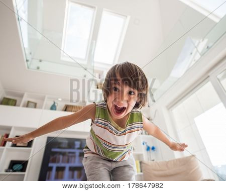 Happy cute little boy at new modern home