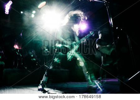 Rock star playing guitar at music live concert