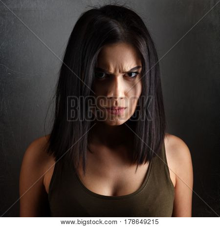 Portrait of angry evil dark woman