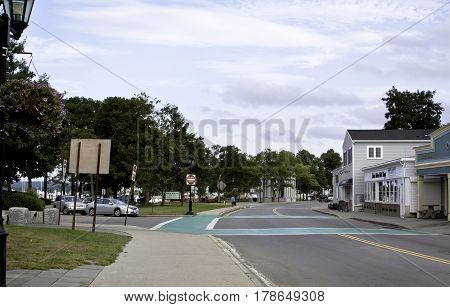 Plymouth, Massachusetts - September 11, 2014 - Wide view of the main street in Plymouth, Massachusetts with stores landmarks and foliage on a bright sunny day with blue skies and clouds in September.