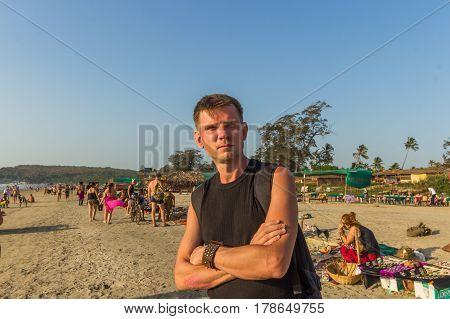 Arambol Beach, Goa, India - February 23, 2017: Young Man At Flea Market On Arambol Beach At Sunset I
