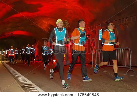 STOCKHOLM SWEDEN - MAR 25 2017: Group of runners in a tunnel with red light the Stockholm Tunnel Run Citybanan 2017. March 25 2017 in Stockholm Sweden