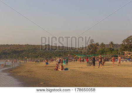 ARAMBOL BEACH GOA INDIA - FEBRUARY 23 2017: Flea market on Arambol beach at sunset in Goa India on February 23 2017. People are walking on beach.