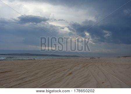 Horizontal landscape of the beach with cars (Belmont - Nine Miles - Beach NSW Australia).