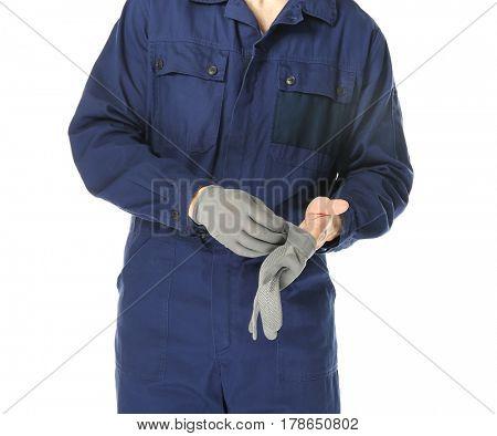 Auto mechanic in uniform on white background