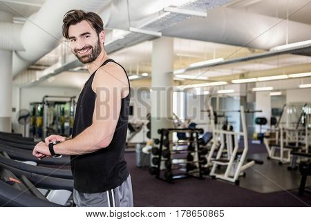 Smiling man on treadmill at the gym