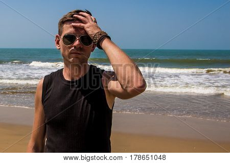 Young Stylish Man On The Beach Of Arabian Sea