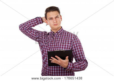 Picture of a tired young man holding insurance forms on isolated background