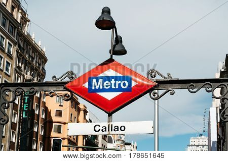 Madrid Spain - September 18 2016: Madrid Metro sign at the entrance to Callao station at Gran Via Street in Madrid. Low angle view horizontal composition