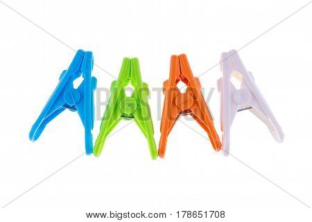 Group of colourful Clothes pegs isolated on a white background.