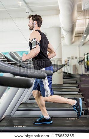Man running on treadmill at the gym