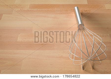 Wire Whisk On Wooden Background