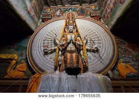 LEH LADAKH INDIA - AUG 6 2015: The Avalokitesvara with a thousand hands at Lamayuru Monastery in Ladakh. The monastery is a Tibetan Buddhist monastery in Lamayouro Ladakh India.