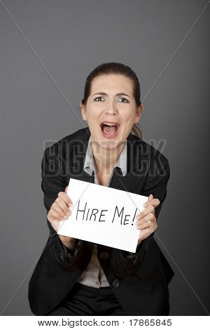 Business woman holding a card board with the text message