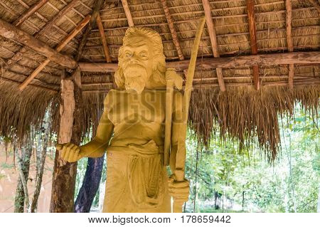 Stone statue of famous chief of Vedda tribe in Sri Lanka