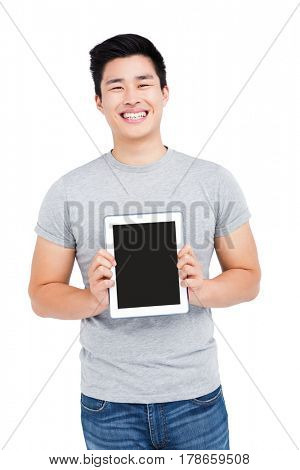 Young man holding digital tablet on white background