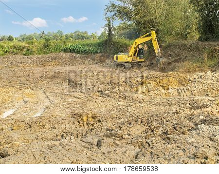 action Excavator working digging a large hole.