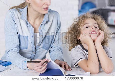 Boy Unwilling To Do Homework