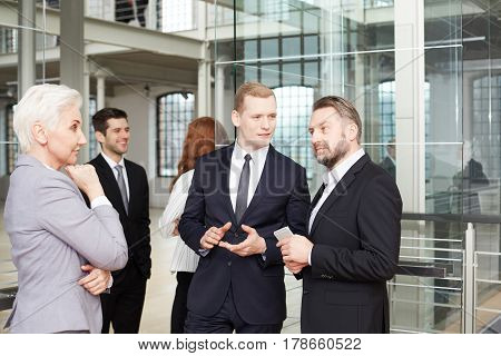Elegant and confident businesswoman negotiating with business partners