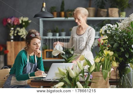 Florists Working In Flower Shop