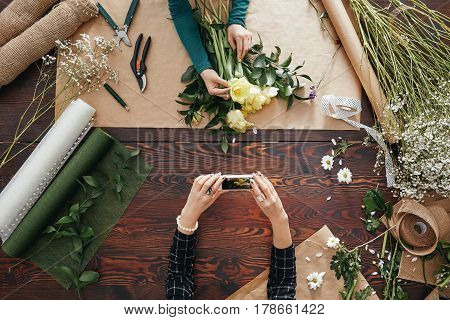 Woman Taking A Picture Of A Bouquet